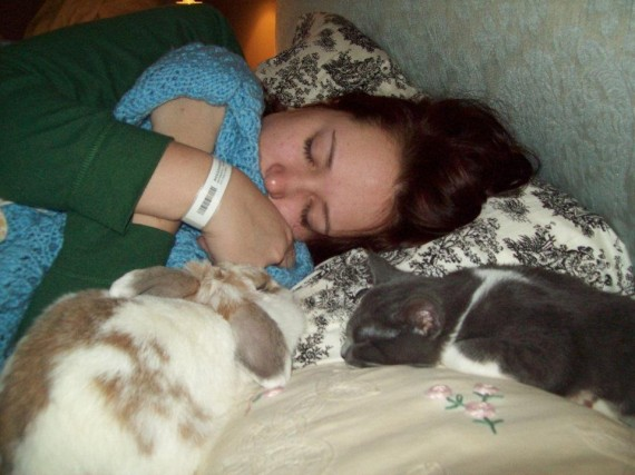"12) ""I had surgery a few years ago and stayed at my parents while I recovered. This is my rabbit and their kitten trying to make me feel better while I slept."""